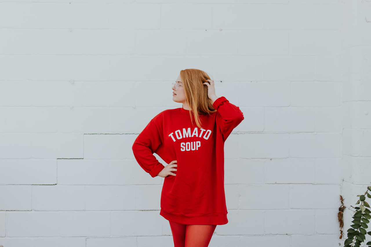woman in red jumper